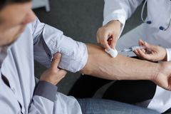Close-up doctor injecting patient with syringe Royalty Free Stock Photography