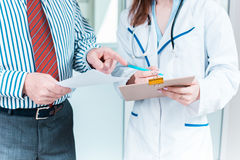 Close-up of doctor and patient hands Stock Photo