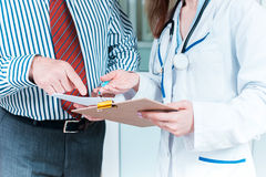 Close-up of doctor and patient hands Stock Photos