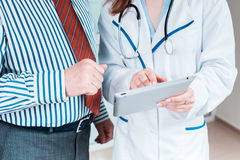 Close-up of doctor and patient hands Royalty Free Stock Photography