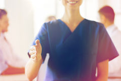Close up of doctor reaching out hand at hospital Stock Photography