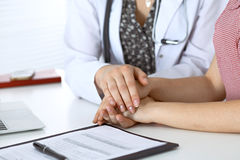 Close-up of doctor  reassuring her female patient. Medical ethics and trust concept Royalty Free Stock Photography