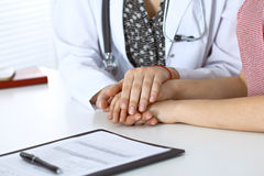 Close-up of doctor  reassuring her female patient. Medical ethics and trust concept Stock Photography
