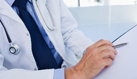 Close up of a doctor showing a document. In an office Royalty Free Stock Photo