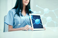 Close up of doctor showing molecules on tablet pc Stock Images