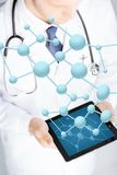 Close up of doctor with stethoscope and tablet pc Stock Photo