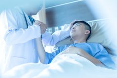 Close-up Doctor taking care of patient in hospital room, Medical royalty free stock photography