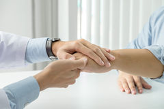Close up of doctor touching patient hand for encouragement and empathy on the hospital, cheering and support patient, Bad news, me Royalty Free Stock Image