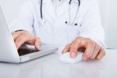 Close-up of doctor using laptop Royalty Free Stock Photo