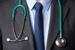 Close Up Of Doctor Wearing Stethoscope Around Neck Stock Images