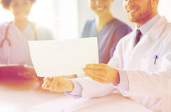 Close up of doctors with cardiogram at hospital Stock Photos