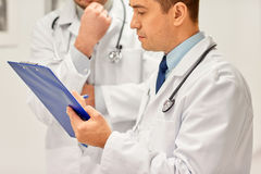 Close up of doctors with clipboard at hospital Royalty Free Stock Photo