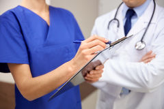 Close up of doctors with clipboard at hospital Stock Images