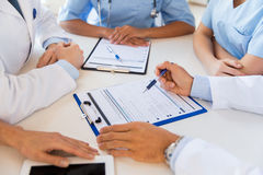 Close up of doctors with clipboards at hospital Stock Images