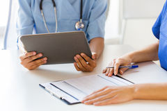 Close up of doctors with tablet pc at hospital Stock Photography