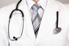 Close up of a doctors white coat and stethoscope Stock Photos