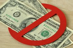 Close-up of dollar bank notes in prohibition sign - No money concept. Close-up of dollar bank notes in prohibition sign. No money concept royalty free stock photos