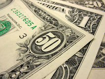 Close-up of dollars. Background of old fifty, twenty  dollars and one US bills Stock Photo