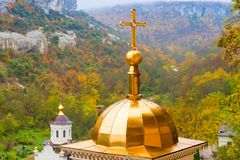 Dome with a cross of an Orthodox church. Close-up of a dome with a cross of an Orthodox church royalty free stock photos
