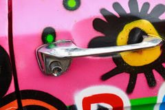 Close up doorhandle of pink colorful car Royalty Free Stock Photos