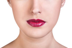 Close-up dos bordos fêmeas lustrosos vermelhos Fotos de Stock Royalty Free
