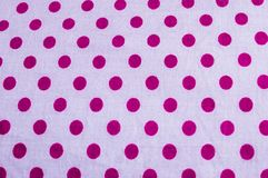 Close up dotted block circular geometric shape cotton print of red color fabric background. Seamless colorful cloth textile royalty free stock images