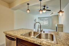 Close-up of double sink with granite counter top in modern flat. Close-up of double sink with granite counter top in modern apartment. Northwest, USA stock image