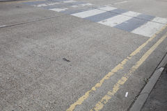 Close-Up of double yellow line on road and Zebra crossing Stock Photography