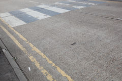Close-Up of double yellow line on road and Zebra crossing Stock Image
