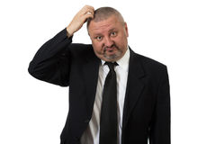 Close up of a doubtful middle aged businessman. Isolated on white background Royalty Free Stock Photos
