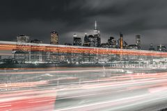 Long exposure of traffic with downtown Manhattan in view royalty free stock photos