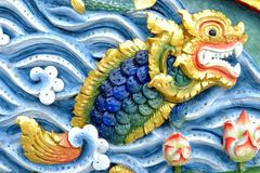 Dragon Fish Sculpture on Thai Temple Wall. Close up Dragon Fish Sculpture on Thai Temple Wall stock image