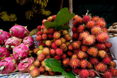 Close-up of Dragon Fruit and Rambutan in Market Stock Image