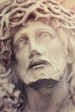 Close up dramatic statue of crucified Jesus Christ (styled vinta Stock Photos