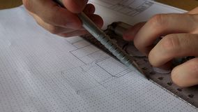 A young engineer learns to work with charts. Close up drawing, macro graphics stock video footage