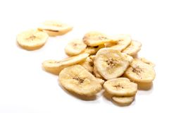 Dried banana slices on white background stock photos