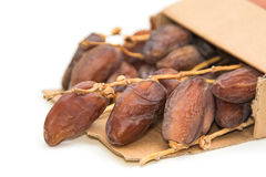 Close up of dried dates in paper box Stock Image