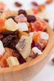 Close up of dried fruits and nuts in a bambus bowl royalty free stock photo