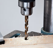 Close up of drill bit above wood Royalty Free Stock Photography