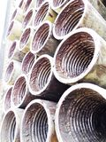 Close up of drill pipe threads. Close up of stacked drill pipe. You can see greasy threads Stock Images