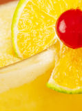 Close up of drink with fruit decoration. A close up of a yellow drink with fruit decoration Stock Photos