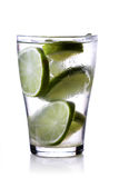 Close-up of drink with lime slices Stock Images
