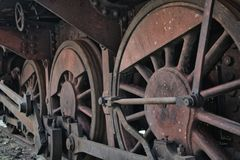 Close-up of the drive wheels and the drive rod of a historic steam locomotive, transport royalty free stock image