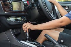 Close up driver left hand shifting the gear stick royalty free stock photo