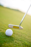 Close up of driver about to hit golf ball. Ready to strike. Close up of driver swinging near golf ball on course stock images