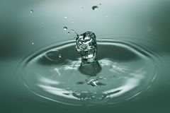 Close-up of Drop Splashing in Water Royalty Free Stock Images