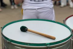 Close-up drum and drum sticks, outdoors. Traditional musical ins. Trument of Brazil royalty free stock photography
