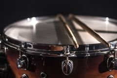 Close-up Drum set in a dark room against the backdrop of the spotlight. Atmospheric background symbol of playing rock or jazz. Drums. Copper plates on a cold royalty free stock image