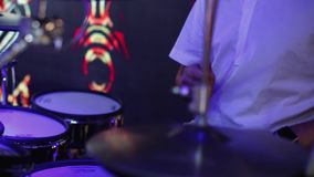 Close up of drummer hand playing drum. Plate on rock concert. Rock band performing on stage stock video footage