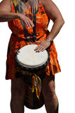 Close up of drumming by woman in bright clothes, Stock Image